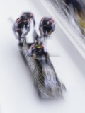 Blurred Action of the Start of 4 Man Bobsled Team