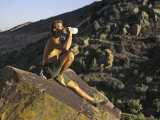 Male Rock Climber Drinking During a Rest Break  USA