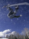 Male Snowboarder Flying Throught the Air  Aspen  Colorado  USA