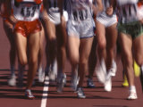 Blurred Action of Women Runners During a Track Race