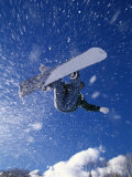 Male Snowboarder Flying Throught the Air