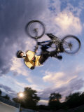 Bmx Cyclist Flys over the Vert