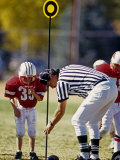 Referee Measuring for a First Down During a During a Pee Wee Football Game  Denver  Colorado  USA