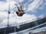 Pole Vaulter Flys over the Bar