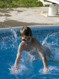 9 Year Old Boy Diving into a Swimming Pool  Woodstock  New York  USA