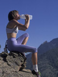 Woman Rock Climber Drinking During a Rest Break