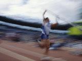 Pole Vaulter Flys over the Bar