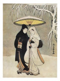 Japanese couple in kimonos walking through the snow holding an umbrella
