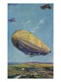 World War I - Zeppelin airship flying with two airplanes over the countryside