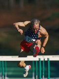 Mature Athlete Competing in Hurdles Race  Atlanta  Georgia  USA