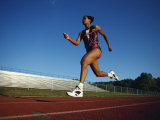Female Runner Training on the Track