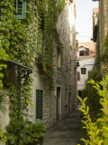Narrow alley with historic stone buildings  Trogir  Dalamatia  Croatia