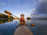 Kayaker on Lower Stillwater Lake near Whitefish  Montana  USA