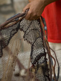 Man mending fishing nets  Stari Grad Town  Hvar Island  Dalmatia  Croatia