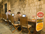 Men working at outdoor internet café  Dubrovnik  Dalmatia  Croatia
