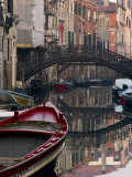 Boats Rest on Still Canal Water  Venice  Italy