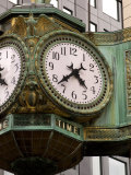 Ornate clock on building in downtown  Chicago  Illinois  USA