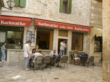 Tables outside coffee shop  Trogir  Dalamatia  Croatia