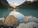 Rocky Mountains and boulders reflected in Lake Louise  Banff National Park  Alberta  Canada