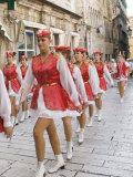 Young woman marching in parade  Split  Dalmatia  Croatia