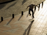 Skateboader Jumping on Tiled Sidwalk  Cuenca  Ecuador