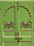Elephants painted on green door  City Palace  Udaipur  India