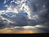 Sunbeams Streaming through Clouds  Masai Mara Game Reserve  Kenya