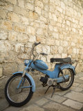 Blue scooter bike by old stone wall  Hvar Town  Hvar Island  Dalmatia  Croatia