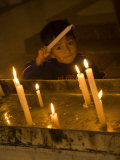 Boy Near Altar of Prayer Candles  Cathedral of Immaculate Conception  Cuenca  Ecuador
