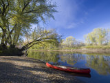 A Canoe rests on the banks of he Connecticut River in Maidstone  Vermont  USA