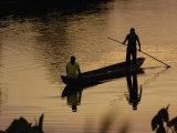 Quichua Indians Poling Dugout Canoe  Amazon Rain Forest  Ecuador