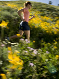 Woman Jogging on a Path Through a Field of Wildflowers