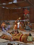 Tlingit Shaman Wearing Spirit Headdress Shakes Rattle over Sick Man
