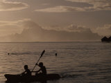 Young Kayakers and Swimmers at Dusk Moorea Island in the Distance