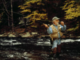 Man Fly-Fishing in a Swift Moving River