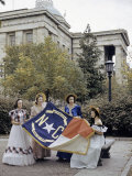 Women in Period Dresses Hold a North Carolina State Flag