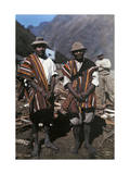Two Men Pose with their Brilliant Ponchos in the Andean Highlands