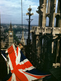 Man Raises Union Jack on Victoria Tower at Houses of Parliament