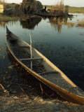 Empty Rowboat in the Water across from a Rubeh Island Village
