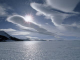 Sun and Lenticular Clouds over a Bare Ice Glacier by Patriot Hills