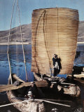Couple of People Sail a Balsas on Titicaca Lake
