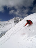 Powder Skier Descends Slope in Front of Lone Mountain