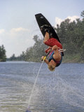 Young Wakeboarder Tries Tries a Flip on Lake of the Woods  Ontario