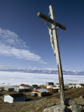 Crucifix Overlooks an Inuit Town Beside Frozen Eclipse Sound