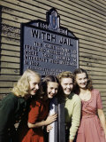 Girls Pose by a Jail That Recalls the Witch Trials of 1692 in Salem
