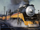 Man Fuels a Steam Locomotive at the Terminal