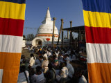 Seated Crowd Gathered Outside a Buddhist Stupa