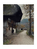 Man Stands Outside a Farmhouse Along a Pathway in the Black Forest