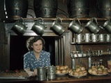 Woman Stands Behind Bar Loaded with Sandwiches at 17th Century Inn