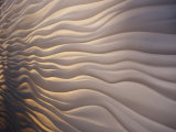 Lighting Illiuminates an Architectural Display of Waves in a Wall